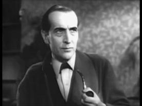 Arthur Wontner em O Triunfo de Sherlock Holmes, filme de 1937